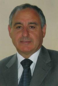 Dr. Charles Sciberras